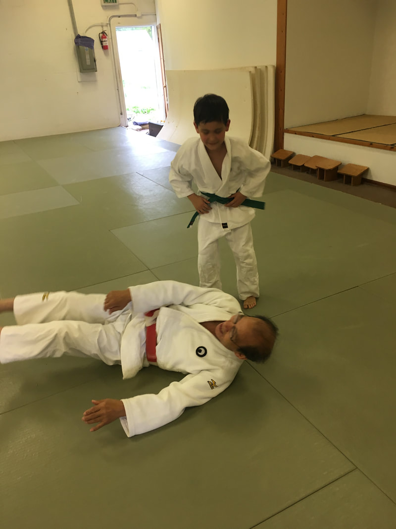 Yasseen sparing with Park Sensei after promoting to Green Belt